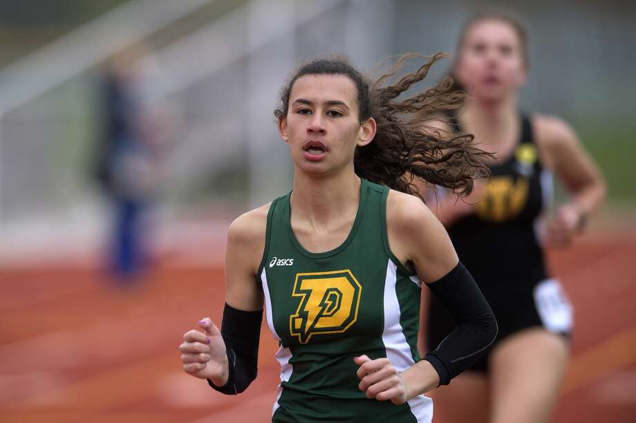 BRITTNEY LOHMILLER | blohmiller@mdn.net Dow's Maija Rettelle races in the 4x6400 relay during the Graves/Swayze Relays Friday afternoon at the Midland Stadium. Photo: Brittney Lohmiller/Midland Daily News/Brittney Lohmiller