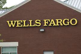 This April 11, 2017, photo shows a Wells Fargo bank in northeast Jackson, Miss. On Friday, April 21, 2017, Wells Fargo agreed  to expand a recently settled class-action lawsuit by an additional $32 million as well as extend claims for fraudulent accounts that may have been opened going back to 2002. (AP Photo/Rogelio V. Solis)