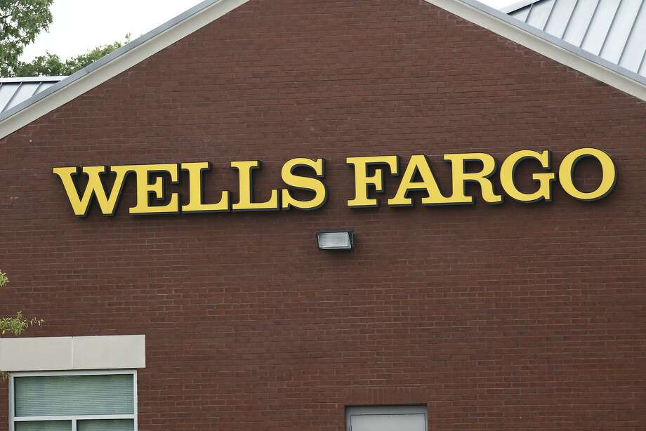 This April 11, 2017, photo shows a Wells Fargo bank in northeast Jackson, Miss. On Friday, April 21, 2017, Wells Fargo agreed to expand a recently settled class-action lawsuit by an additional $32 million as well as extend claims for fraudulent accounts that may have been opened going back to 2002. (AP Photo/Rogelio V. Solis) Photo: Rogelio V. Solis, Associated Press