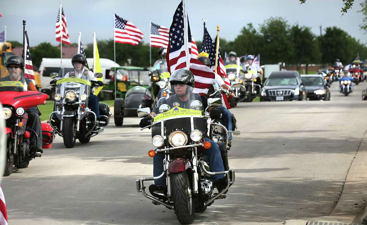 Members of the Patriot Guard Riders escourt the cremains of five unclaimed veterans that were found in the basement of the Potter County Courthouse. The five received Full Military Honors at Fort Sam Houston National Cemetery on Friday, April 21, 2017.