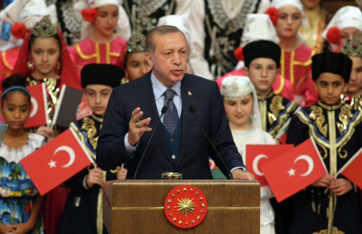 Turkish President Recep Tayyip Erdogan delivers a speech Thursday as he receives the children attending the 39th TRT International Children's Festival at the presidential Complex in Ankara. (Photo by Adem Altan/AFP/Getty Images)
