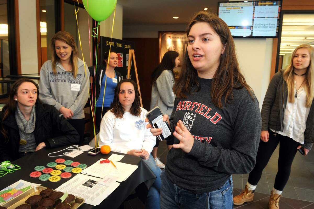 Jessica Held, a Fairfield University sophomore from South Pelham, NY speaks with other students during a cupcake give away to bring attention to the plight of Dr. Bekele Gerba, a political activist currently in prison in Ethiopia.