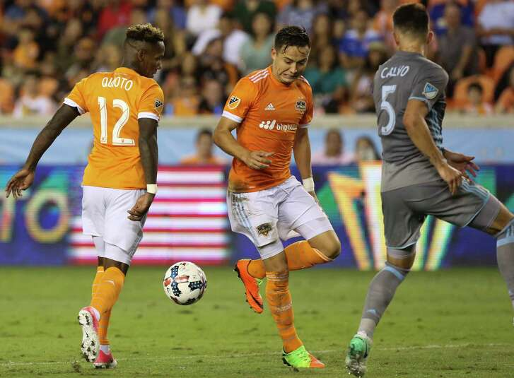 Houston Dynamo forward Romell Quioto (12) and forward Mauro Manotas (19) miss a pass during the second half of the game at BBVA Compass Stadium Saturday, April 15, 2017, in Houston. ( Yi-Chin Lee / Houston Chronicle )