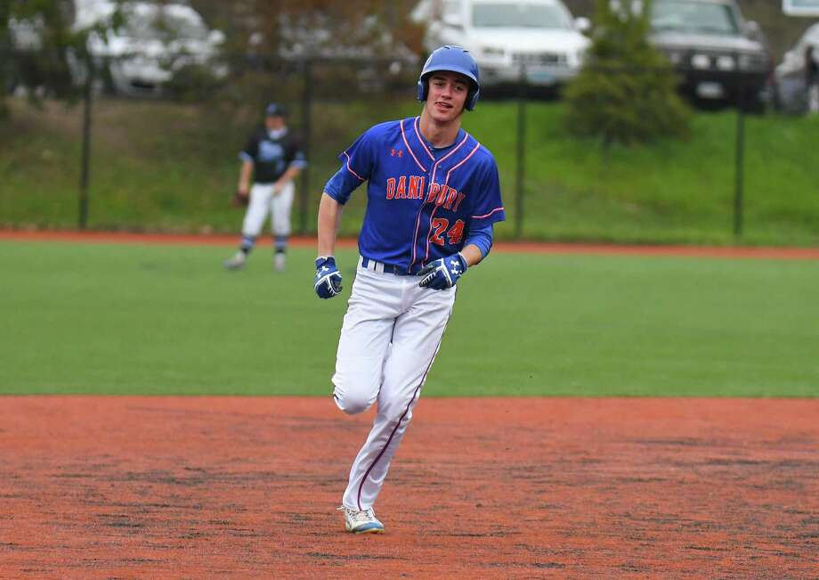 Brian McCarthy (24) of the Danbury Hatters rounds second after hitting a home run during a game against the Darien Blue Wave at Darien High School on April 21, 2017 in Darien, Connecticut. Photo: Gregory Vasil / For Hearst Connecticut Media / Connecticut Post Freelance