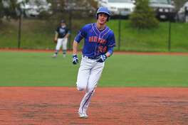 Brian McCarthy (24) of the Danbury Hatters rounds second after hitting a home run during a game against the Darien Blue Wave at Darien High School on April 21, 2017 in Darien, Connecticut.