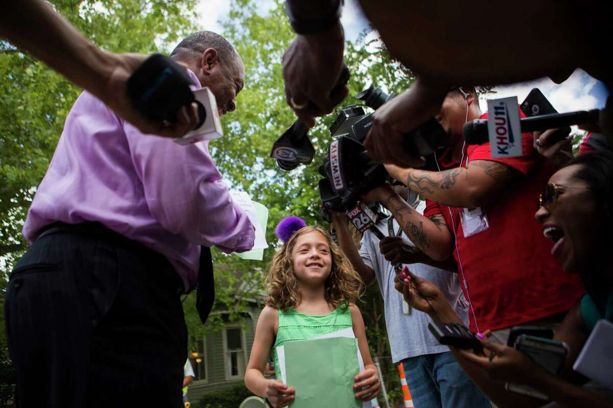 Houston Mayor Sylvester Turner holds a letter 8-year old Sophie Blitz sent him about the sidewalks of her neighborhood needing repair, Friday, April 21, 2017, in Houston. On Friday, Mayor Turner went to her home, met her family and later to the family to eat gelato.