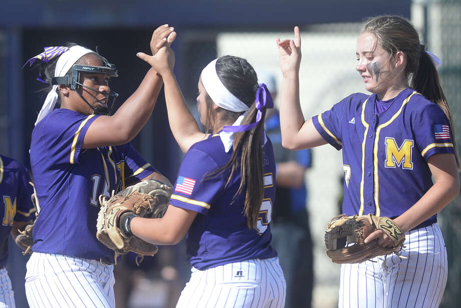 Midland High pitcher Deandra Allen (left) is congratulated by teammates after striking out a Frenship batter on March 21, 2017, at Audrey Gill Sports Complex.  James Durbin/Reporter-Telegram Photo: James Durbin