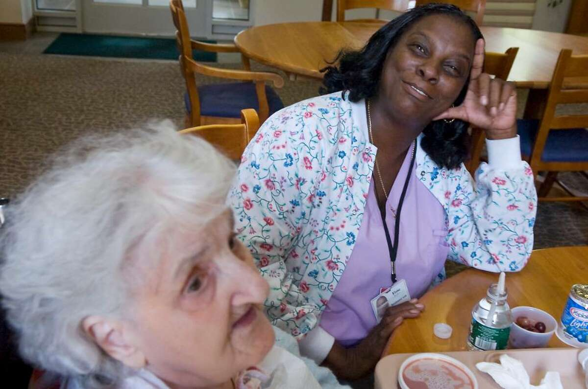Eloise Knight, CNA, talks to patient Gertrude Passiotti at the Richard L. Rosenthal Hospice Residence in Stamford, Conn. on Friday June 4, 2010.