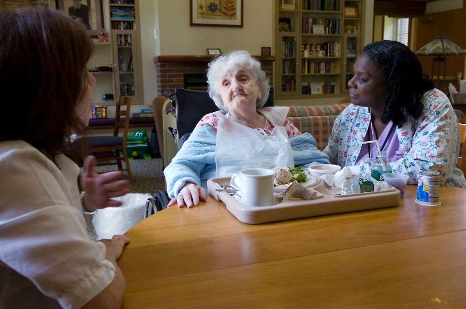 Holly Brookstein, Director of Development, and Eloise Knight, CNA, talk to patient Gertrude Passiotti at the Richard L. Rosenthal Hospice Residence  in Stamford, Conn. on Friday June 4, 2010. Photo: Kathleen O'Rourke / Stamford Advocate
