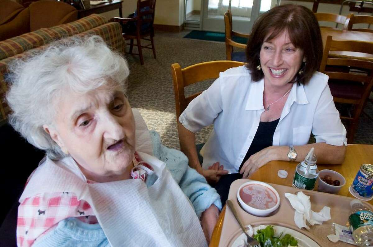 FILE - Holly Brookstein, Director of Development talks to patient Gertrude Passiotti at the Richard L. Rosenthal Hospice Residence in 2010.
