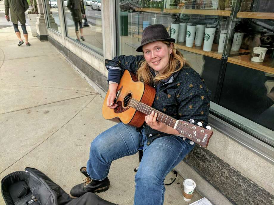 Ivy Spillman, 24, has been in Fairfield County with her husband for the past two or three years, she said, and has been street-performing on Greenwich Avenue and other hot spots to fill the New England air with her midwestern flare. Photo: Jennifer Turiano / Hearst Media CT