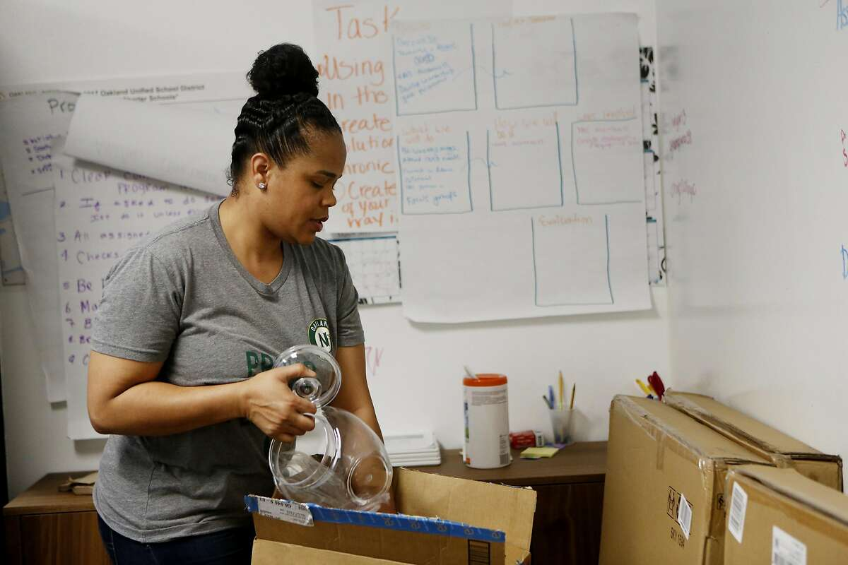 Tatiana Larkin, the COO of Oakland Natives, packs up items in the office on Friday, April 21, 2017, in Oakland, Calif.