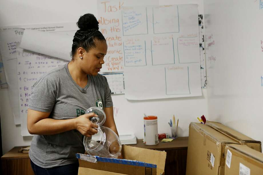 Tatiana Larkin, above, with Oakland Natives Give Back, packs up items in the office as she and Erica Harris, below, prepare to move from 17th Street near Telegraph to shared quarters in the Pill Hill neighborhood. Photo: Natasha Dangond, The Chronicle