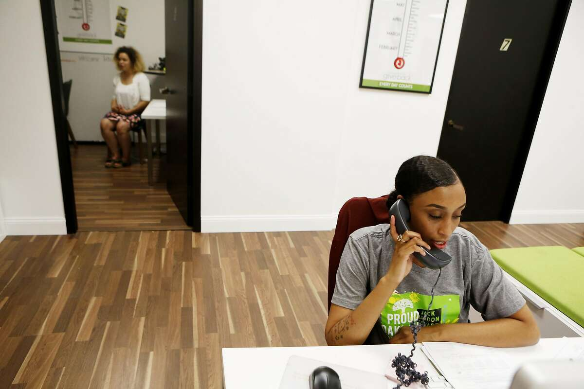 Kristen Stephenson calls to inform a parent that their daughter has won the perfect attendance award given by Oakland Natives, and will be granted a prize of $500, at the Oakland Natives office on Friday, April 21, 2017, in Oakland, Calif.