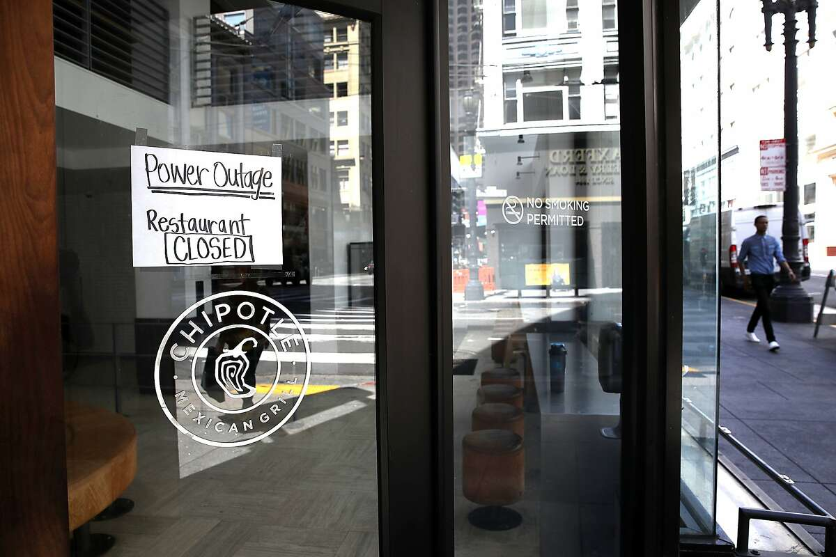 SAN FRANCISCO, CA - APRIL 21: A sign is posted on the door of a Chipotle restaurant during a citywide power outage on April 21, 2017 in San Francisco, California. Nearly 100,000 Pacific Gas and Electric (PG&E) customers in San Francisco are without power due to a fire at a PG&E substation. Street lights and public transportation that is powered by electricity are also out of service. (Photo by Justin Sullivan/Getty Images)