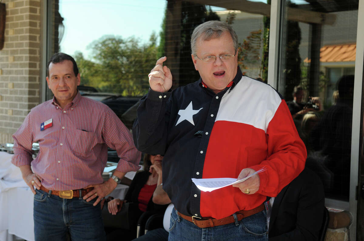 GOP candidate Paul Bettencourt, right, with fellow candidate Paul Simpson, speaks during a rally for voters and supporters of Senate District 7 (SD-7) on the patio of Hasta La Pasta in Spring on Saturday.