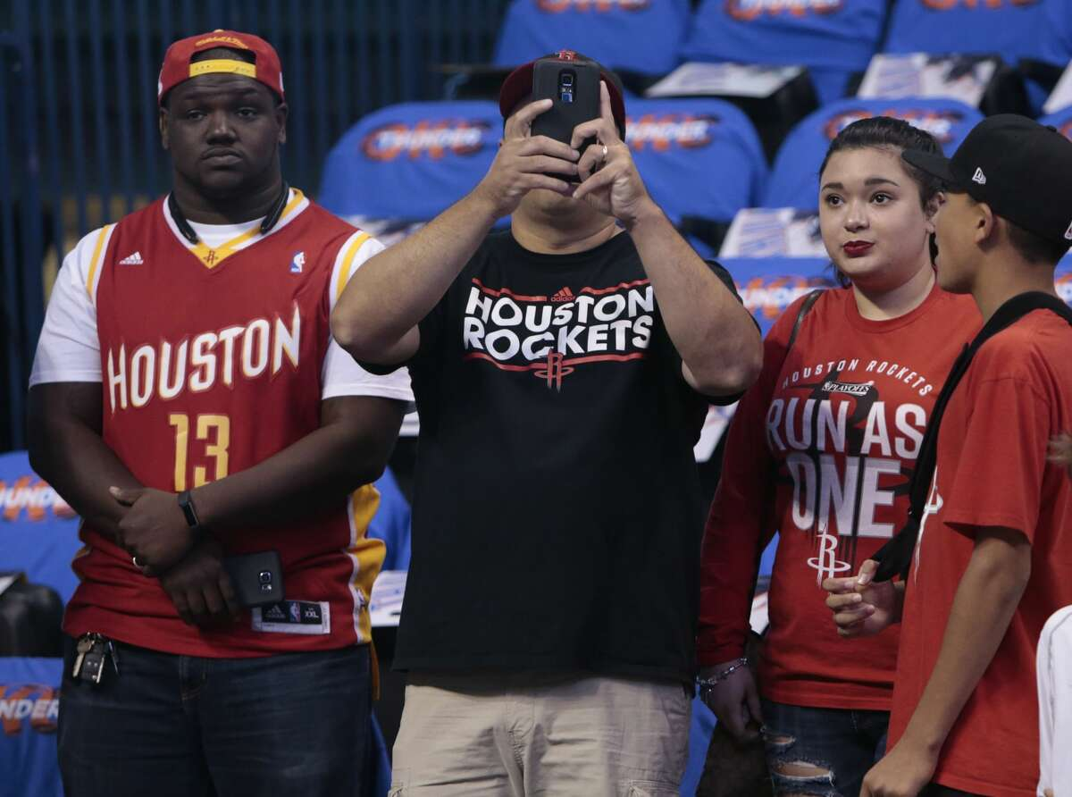 Houston Rockets fans watch warm ups before Game 3 of the NBA Western Conference first-round playoff series at Chesapeake Energy Arena on Friday, April 21, 2017, in Oklahoma City. ( Brett Coomer / Houston Chronicle )