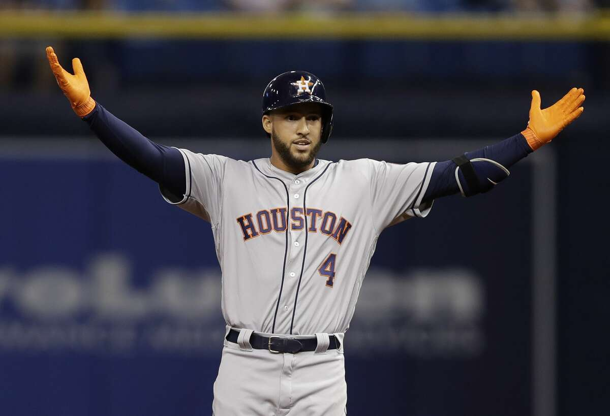 Houston Astros' George Springer celebrates after hitting a double off Tampa Bay Rays starting pitcher Alex Cobb during the first inning of a baseball game Friday, April 21, 2017, in St. Petersburg, Fla. (AP Photo/Chris O'Meara)