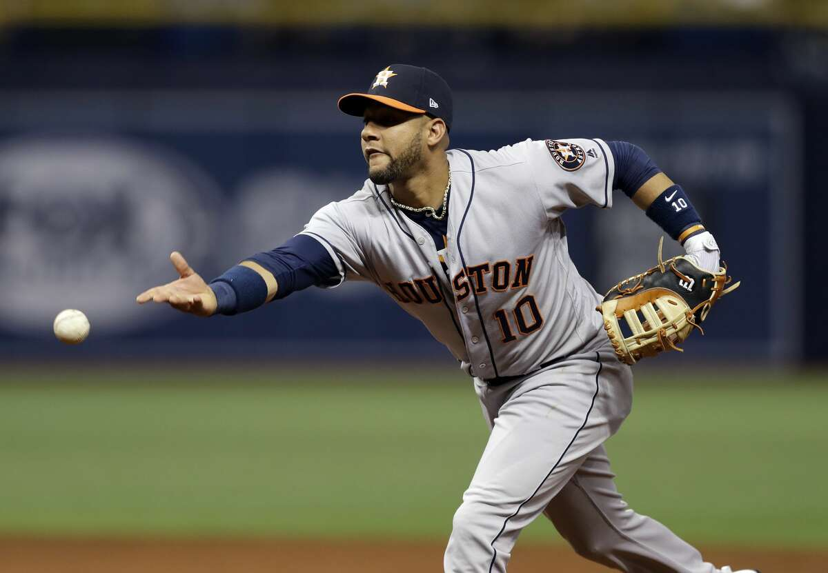 Houston Astros first baseman Yuli Gurriel throws out Tampa Bay Rays' Corey Dickerson at first during the second inning of a baseball game Friday, April 21, 2017, in St. Petersburg, Fla. (AP Photo/Chris O'Meara)