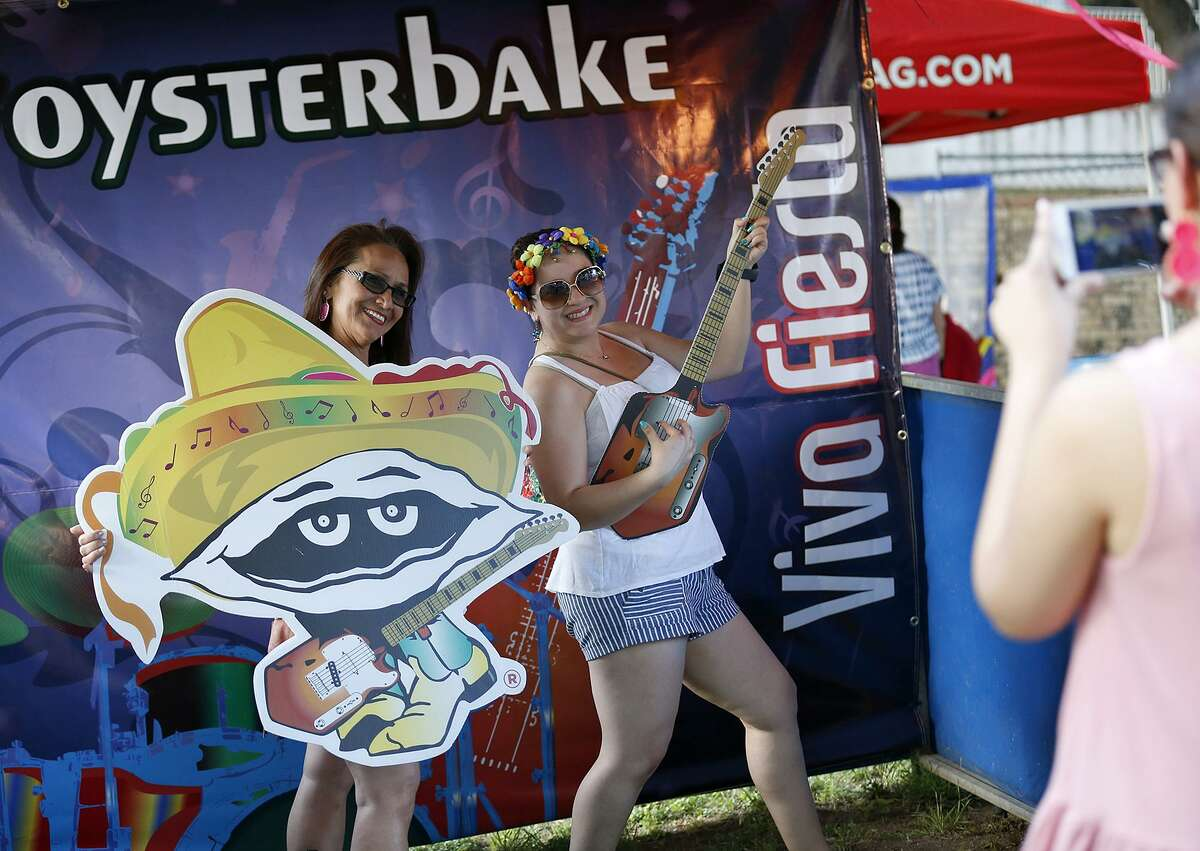 Elizabeth Burrell (left) and Miriam Moreno pose for photos during the 2017 Fiesta Oyster Bake on the St. Mary's University campus.