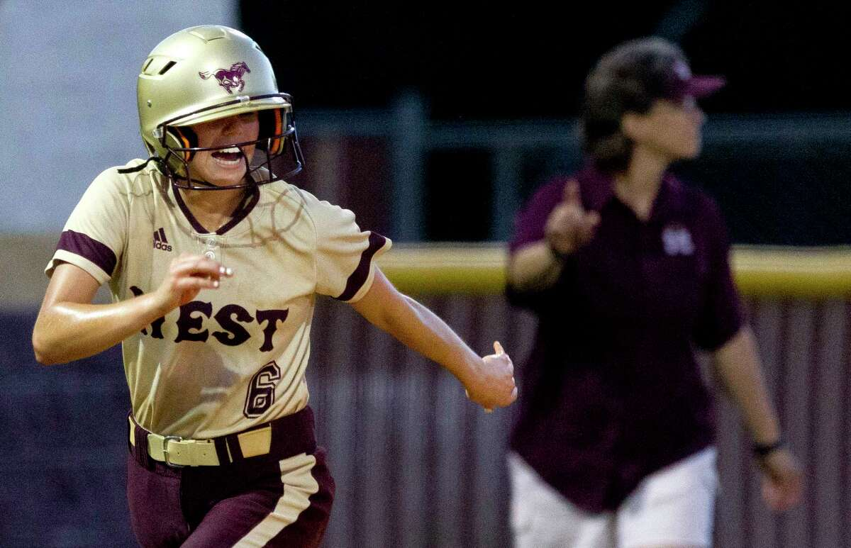 Lauren Corley #6 of Magnolia West cheers as she comes in to score on Kaitlyn Goike's 2-RBI double during the fourth inning of a District 20-5A high school softball game, Friday, April 21, 2017, in Magnolia.