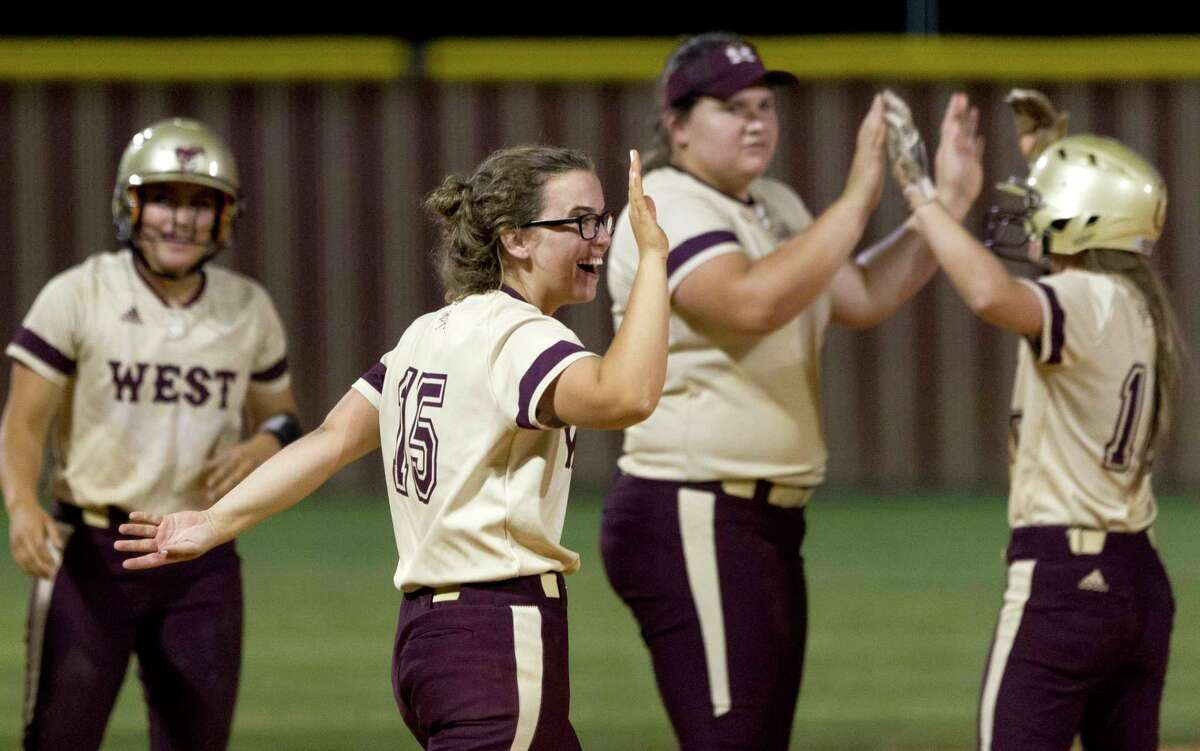 Magnolia West players celebrate after defeating Huntsville 10-0 in five innings to clinch a share of the District 20-5A softball title, Friday, April 21, 2017, in Magnolia.