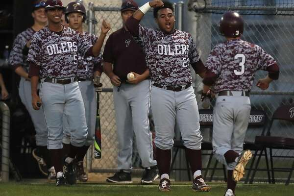 Pearland's Mason Lyle (3) celebrates his run scored with teammates in the fourth inning of the Pearland-George Ranch High School baseball game at George Ranch, Friday, April 21, 2017, in Houston. ( Karen Warren / Houston Chronicle )