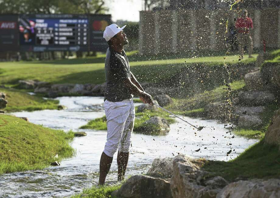 Tony Finau sprays muddy water on himself getting his ball up to the 18th green where he missed the par save and fell into a tie for the lead at 8 under during the second round of the Valero Texas Open at TPC San Antonio Oaks Course on April 21, 2017. Photo: Tom Reel, Staff / San Antonio Express-News / 2017 SAN ANTONIO EXPRESS-NEWS