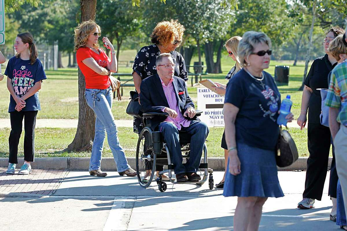 Toby Cole, center, waits in line to vote at Nottingham Park last fall. The Houston attorney is among disability rights advocates who praised a judge's critical remarks about polling access.
