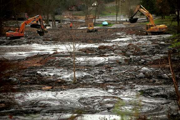 **FILE** Clean-up crews work, Nov. 9, 2000, to remove coal sludge from the stream on Coldwater Road near Inez, Ky. The state Department of Environmental Protection said Tuesday, Oct. 7, 2003, it has settled its lawsuit against a Kentucky-based Massey Energy subsidiary over a massive slurry spill that polluted the Tug Fork and Big Sandy rivers in October 2000. The settlement with Martin County Coal of Martin County, Ky., reimburses the state Division of Natural Resources and the DEP for the cost of responding to the spill and the loss of aquatic life in the Tug Fork River, said Perry McDaniel, chief of the DEP's office of legal services. (AP Photo/Rhonda Simpson, File)