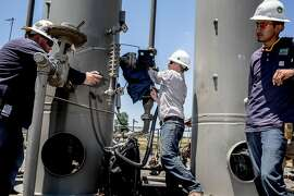 Southwestern Energy workers check on a suspected pipe leak at a well pad site in Damascus, Ark., June 28, 2016. The reputation of natural gas as a ?clean energy? in the fight against climate change rests in part on the abilities of workers tracking down and eliminating methane leaks in the nation?s pipeline infrastructure. (Andrea Morales/The New York Times)