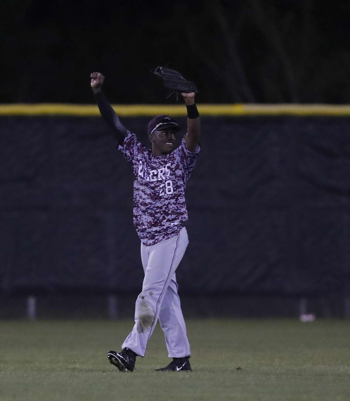 Pearland's AJ Knowles celebrates after catching George Ranch Joseph Menefee's pop out for the final out in the seventh inning of the Pearland-George Ranch High School baseball game at George Ranch, Friday, April 21, 2017, in Houston. ( Karen Warren / Houston Chronicle )