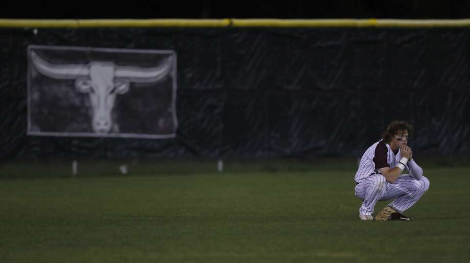 George Ranch's Joseph Menefee reacts during a pitching change after Pearland scored five runs in the sixth inning of the Pearland-George Ranch High School baseball game at George Ranch, Friday, April 21, 2017, in Houston. ( Karen Warren / Houston Chronicle ) Photo: Karen Warren/Houston Chronicle