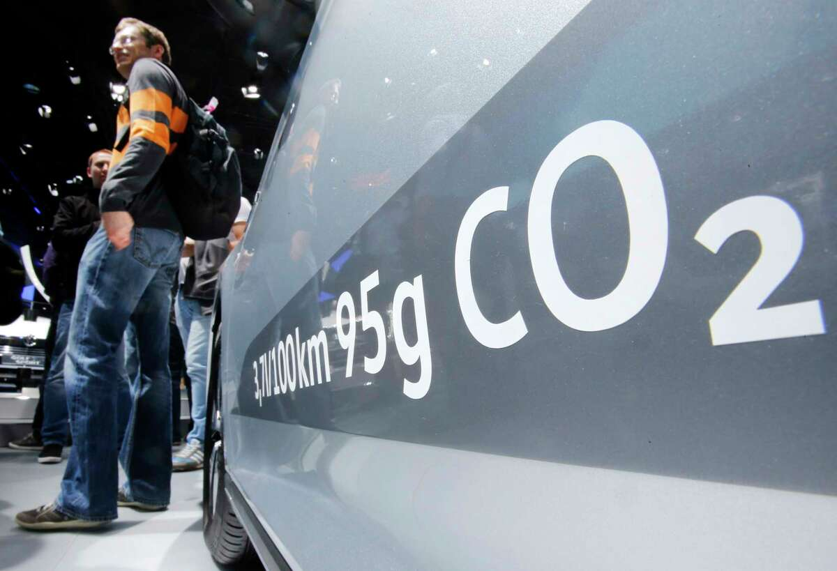 FILE - In this Sept. 22, 2015, file photo, the amount of carbon dioxide emissions is written on a Volkswagen Passat Diesel at the Frankfurt Car Show in Frankfurt, Germany. On Friday, April 21, 2017, a judge ordered Volkswagen to pay a $2.8 billion criminal penalty in the United States for cheating on diesel emissions tests, blessing a deal negotiated by the government for a Â?