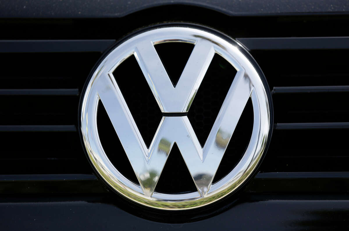 FILE - This Sept. 21, 2015, file photo, shows the Volkswagen logo on a car for sale at New Century Volkswagen dealership in Glendale, Calif. On Friday, April 21, 2017, a judge ordered Volkswagen to pay a $2.8 billion criminal penalty in the United States for cheating on diesel emissions tests, blessing a deal negotiated by the government for a Â?