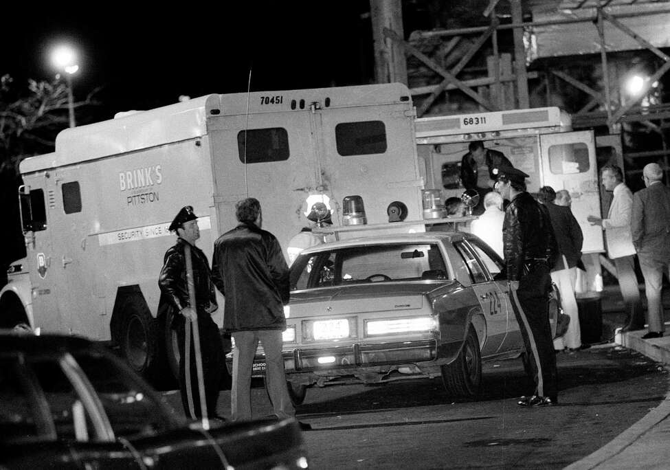 FILE - In this Oct. 21, 1981, file photo, police are at the scene of a Brinks armored truck robbery at the Nanuet Mall in Nanuet, N.Y., where multiple Nyack police officers and a Brinks guard were killed earlier during the robbery. Judith Clark is a former Weather Underground member who has served 35 years of a 75-year-to-life sentence for her role in the robbery, will be eligible for parole in 2017 following a commutation from New York Gov. Andrew Cuomo on Friday, Dec. 30, 2016. (AP Photo/File) ORG XMIT: NYR107