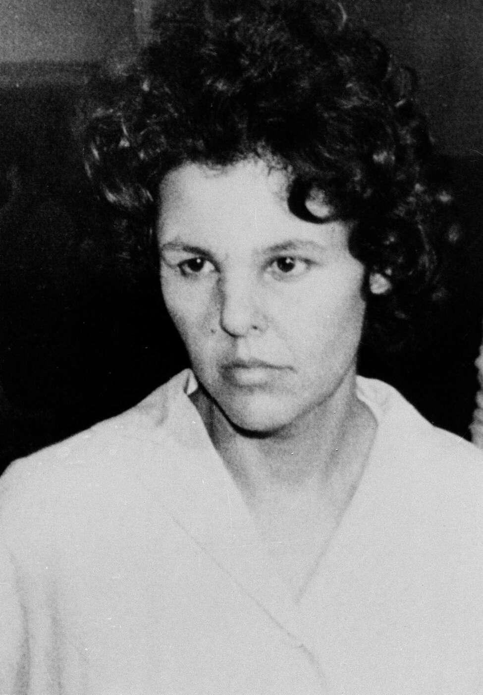 FILE - In this Oct. 21, 1981 file photo, Judith Clark is taken into police custody in Nanuet, N.Y. Clark, a former radical who drove a getaway car during the 1981 Brinks armored car robbery will be eligible for parole in 2017 following a commutation from New York Gov. Andrew Cuomo on Friday, Dec. 30, 2016. (AP Photo/David Handschuh, File) ORG XMIT: NYR108