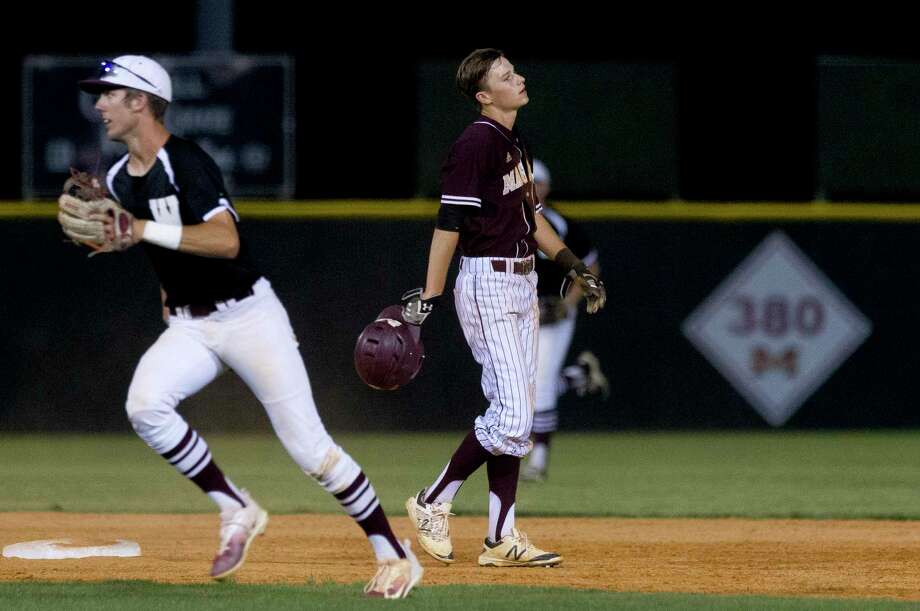 Bradley Baughman #17 of Magnolia West reacts after a ground ball by Cody Windisch ended the sixth inning of a District 20-5A high school baseball game, Friday, April 21, 2017, in Magnolia. Photo: Jason Fochtman, Staff Photographer / © 2017 Houston Chronicle