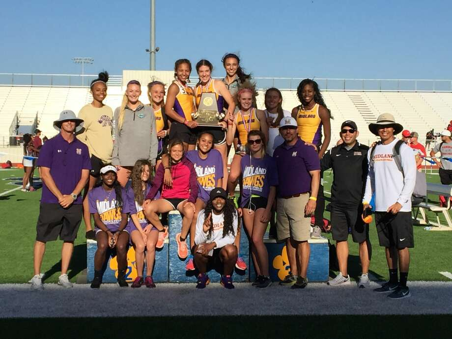 The Midland High girls track team poses with its first-place trophy after winning the team championship at the Districts 1-6A/2-6A area meet, Friday at Peoples Bank Stadium in Wolfforth. Photo: Courtesy Photo