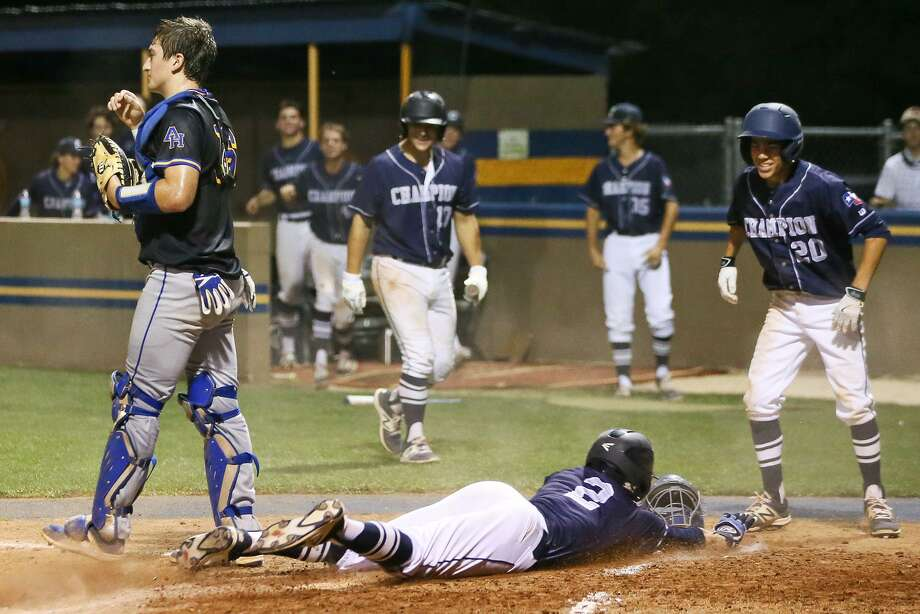 Boerne Champion's Luke Boyers slides into hope plate so score the go ahead run as Ramiro Cervera waits to greet him in the top of the seventh inning during their District 26-5A high school baseball game at Alamo Heights on Friday, April 21, 2017. Champion scored three runs in seventh inning to beat Alamo Heights 3-1.  MARVIN PFEIFFER/ mpfeiffer@express-news.net Photo: Marvin Pfeiffer, Staff / San Antonio Express-News / Express-News 2017