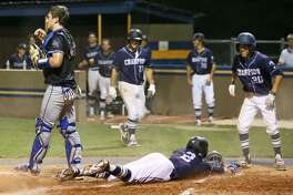 Boerne Champion's Luke Boyers slides into hope plate so score the go ahead run as Ramiro Cervera waits to greet him in the top of the seventh inning during their District 26-5A high school baseball game at Alamo Heights on Friday, April 21, 2017. Champion scored three runs in seventh inning to beat Alamo Heights 3-1.  MARVIN PFEIFFER/ mpfeiffer@express-news.net