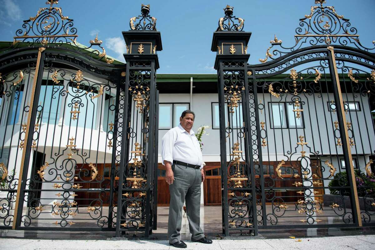 Rudi D. Sardjoe, widely acknowledged as Suriname?•s richest businessman, stands for a portrait by the gates at his house on Sunday, March 12, 2017 in Paramaribo, Suriname. (Stephanie Strasburg/Post-Gazette)