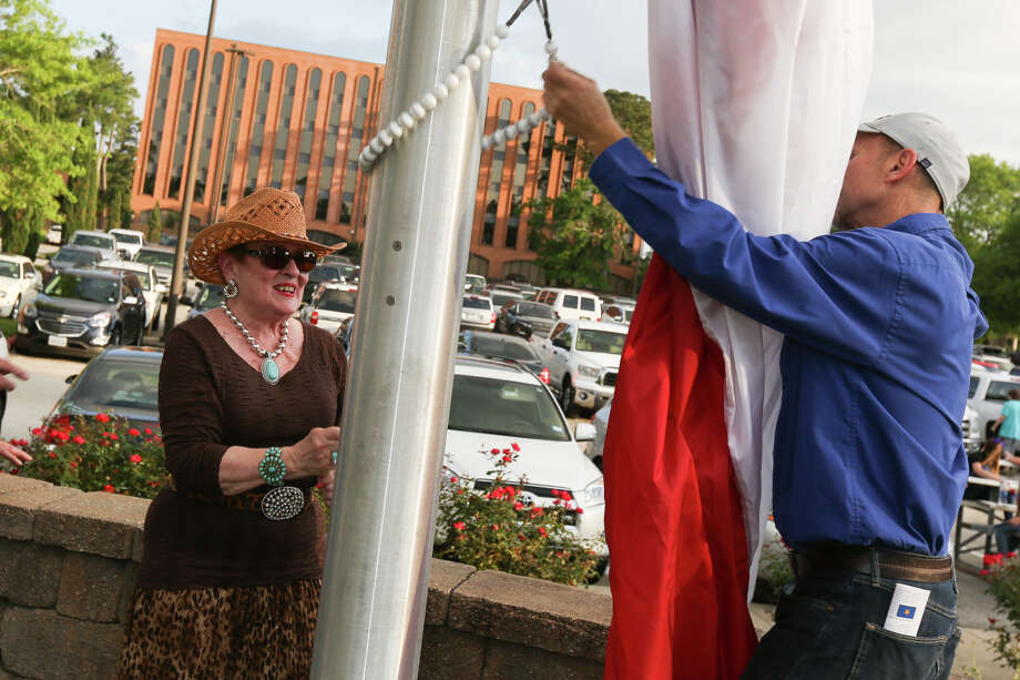 Gayle Laminack, representing the Conroe Symphony Orchestra, raises the Lone Star Flag during the annual flag raising ceremony on Friday, April 21, 2017, at Lone Star Monument and Historical Flag Park. Photo: Michael Minasi, Staff Photographer / © 2017 Houston Chronicle