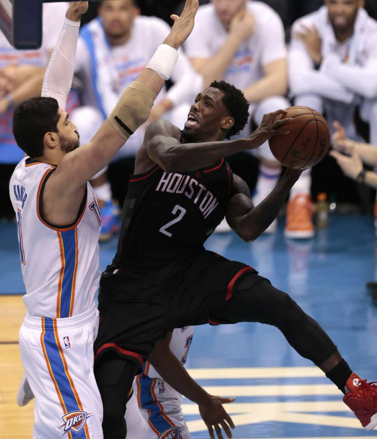 Houston Rockets guard Patrick Beverley (2) is knockdd out of bounds by Oklahoma City Thunder center Enes Kanter (11) during the fourth quarter of Game 3 of the NBA Western Conference first-round playoff series at Chesapeake Energy Arena on Friday, April 21, 2017, in Oklahoma City. The Thunder beat the Rockets 115-113. The Rockets lead the best-of-seven series 2-1. ( Brett Coomer / Houston Chronicle )