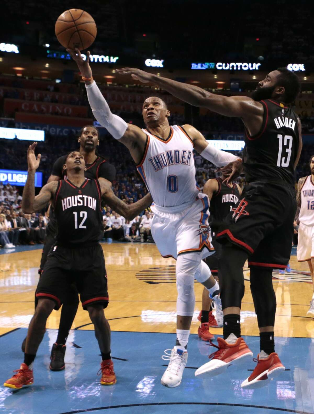 Oklahoma City Thunder guard Russell Westbrook (0) drives to the basket past Houston Rockets guard James Harden (13) during the second half of Game 3 of the NBA Western Conference first-round playoff series at Chesapeake Energy Arena on Friday, April 21, 2017, in Oklahoma City. The Thunder beat the Rockets 115-113. The Rockets lead the best-of-seven series 2-1. ( Brett Coomer / Houston Chronicle )