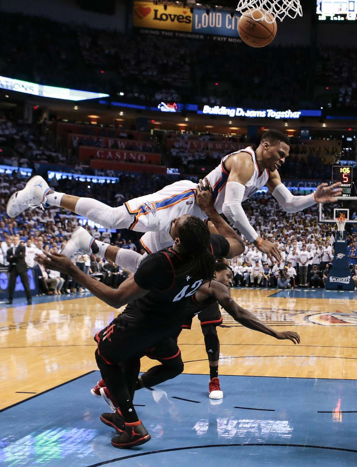 Oklahoma City Thunder guard Russell Westbrook (0) slams into Houston Rockets center Nene (42) to draw a fould during the second half of Game 3 of the NBA Western Conference first-round playoff series at Chesapeake Energy Arena on Friday, April 21, 2017, in Oklahoma City. The Thunder beat the Rockets 115-113. The Rockets lead the best-of-seven series 2-1. ( Brett Coomer / Houston Chronicle )