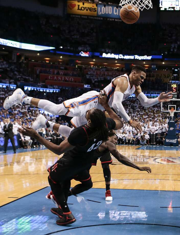Oklahoma City Thunder guard Russell Westbrook (0) slams into Houston Rockets center Nene (42) to draw a fould during the second half of Game 3 of the NBA Western Conference first-round playoff series at Chesapeake Energy Arena on Friday, April 21, 2017, in Oklahoma City. The Thunder beat the Rockets 115-113. The Rockets lead the best-of-seven series 2-1. ( Brett Coomer / Houston Chronicle ) Photo: Brett Coomer/Houston Chronicle