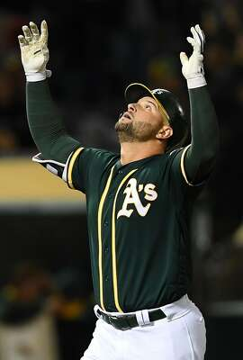OAKLAND, CA - APRIL 21:  Yonder Alonso #17 of the Oakland Athletics celebrates after he hit a solo home run against the Seattle Mariners in the bottom of the six inning at Oakland Alameda Coliseum on April 21, 2017 in Oakland, California.  (Photo by Thearon W. Henderson/Getty Images)