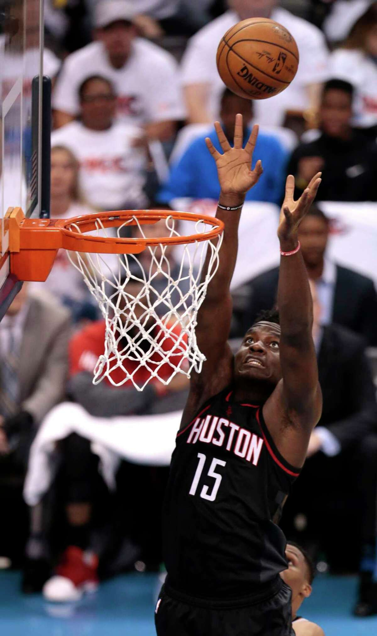 Houston Rockets center Clint Capela (15) goes up for a dunk against the Oklahoma City Thunder during the second quarter of Game 3 of the NBA Western Conference first-round playoff series at Chesapeake Energy Arena on Friday, April 21, 2017, in Oklahoma City. ( Brett Coomer / Houston Chronicle )