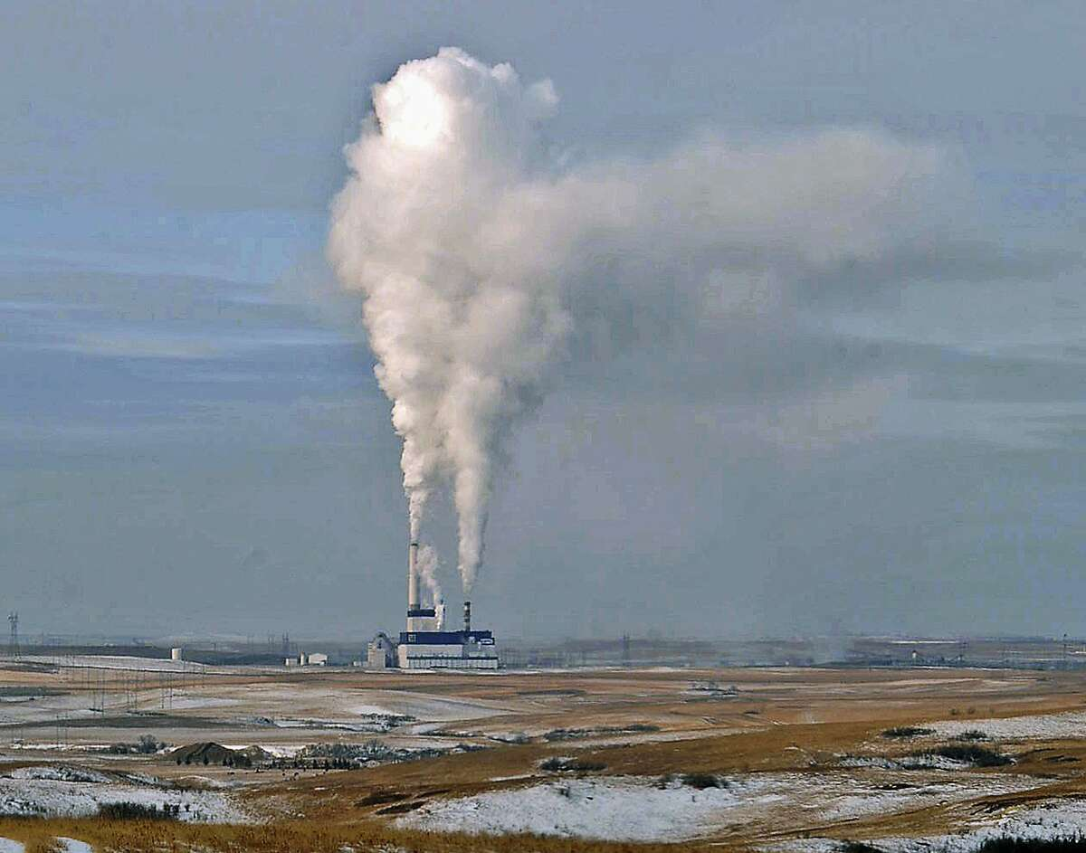FILE - In this Jan. 30, 2008, file photo, steam rises from the coal-fired Milton Young Power Plant near Center, N.D. The Environmental Protection Agency, EPA has been roiled by turmoil during its first week under Trump, as members of the transition team issued what it has described as a temporary freeze on all contract approvals and grant awards. (Tom Stromme/The Bismarck Tribune via AP, File)